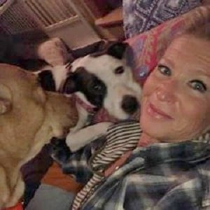 Tracy with dogs in training in her home