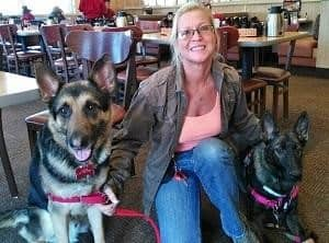 "Tracy with service dogs ""Arrow"" & ""Freedom"""